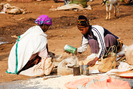 Dorze ethnic people sell food in a street market, on Aug 8, 2007 in Arba Minch, Ethiopia