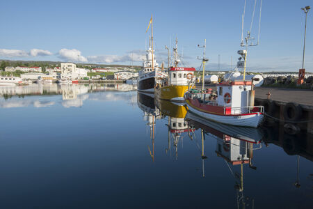 Anchored fishing boat in Husavik harbor on June 23, 2014 in Husavik, Iceland  Husavik has become Iceland s premier whale watching destination photo
