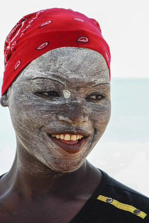 Unidentified Makua woman, with traditional white face mask