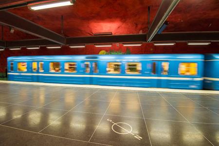 arrives: Train arrives Solna Centrum metro station, Stockholm, Sweden