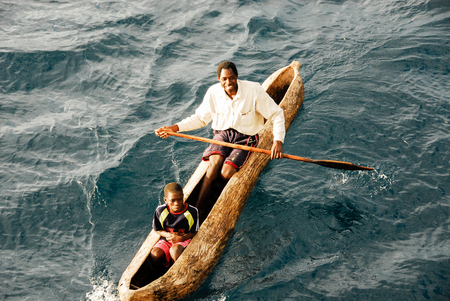 malawian: Unidentified man sails in traditional boat on lake Malawi on August 17, 2009 in Chilumba, Malawi