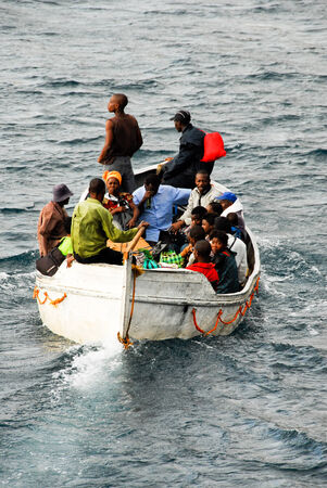 embark: Passengers approach in a boat to embark the ferry MV Ilala on August 17, 2009 in Chilumba, Malawi Editorial