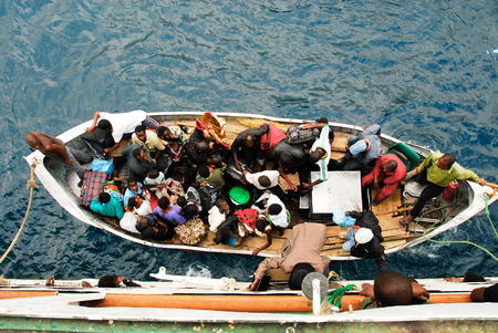 embark: Passengers prepare to embark the ferry MV Ilala on August 17, 2009 in Chilumba, Malawi
