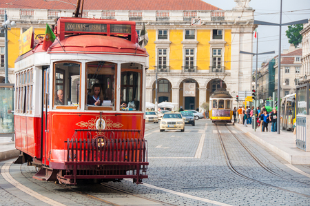 streetcar: Traditional tram at the Commerce square on October 25, 2013 in Lisbon, Portugal The Lisbon tramway network operates since 1873  Editorial