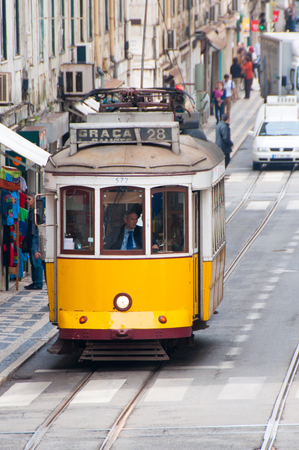 baixa: Famous tram 28 in Baixa district on October 25, 2013 in Lisbon, Portugal The Lisbon tramway network operates since 1873  Editorial