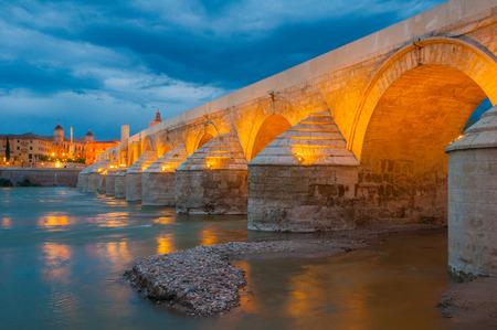 cordoba: Roman Bridge of Cordoba at night, Spain Stock Photo