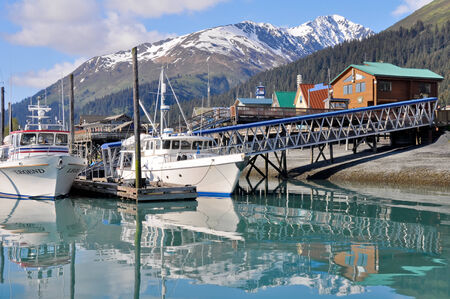 fishing cabin: Harbor of Seward village in Alaska Editorial