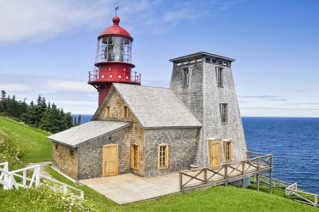 Pointe a la Renommee lighthouse in Quebec, Canada photo
