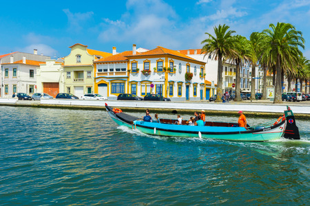city park boat house: Moliceiro boats sail along the central canal  on August 21, 2015 in Aveiro, Portugal
