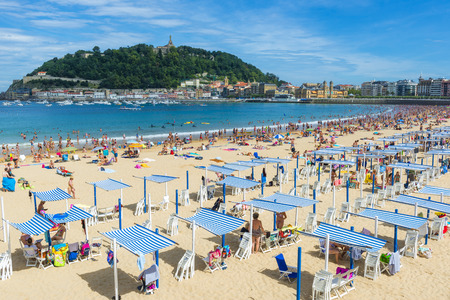 beaches of spain: La Concha beach in a sunny day, San Sebastian, Spain Stock Photo