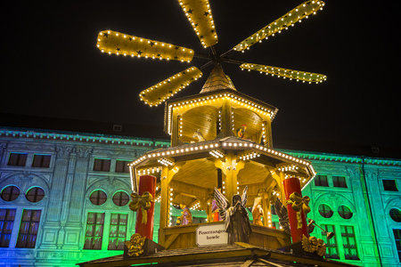 christkindlmarkt: Wooden carousel of Christmas Market at Munich Residence, Germany