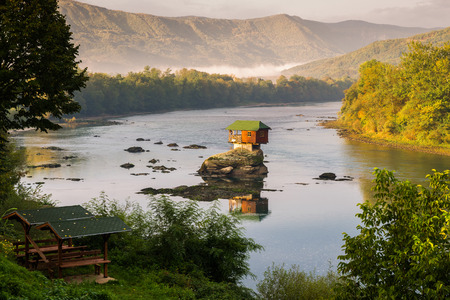 architecture bungalow: Lonely house on the river Drina in Bajina Basta, Serbia Stock Photo