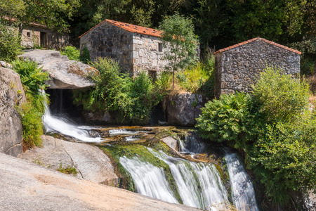 watermills: Waterfall and watermills of Barosa river in Barro, Pontevedra, Spain Stock Photo