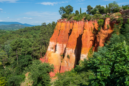 Reddish rock formations made of ocher village near Roussillon, Provence, France