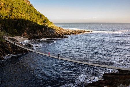 Suspension Bridge over the Storms River Mouth in Tsitsikamma National Park, South Africa Stock Photo
