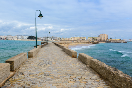 Promenade linking San Sebastain castle with Cadiz city, Spain