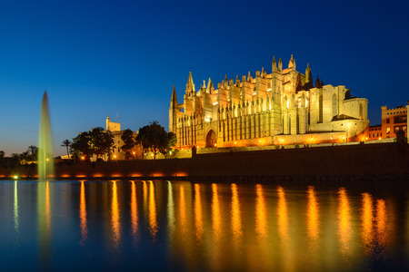 Illuminated Cathedral of Palma de Mallorca seen from Parc de la Mar, Spain