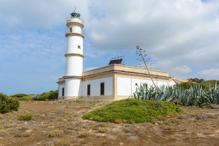 Lighthouse at Cap de Ses Salines. Majorca, Spain Stock Photo