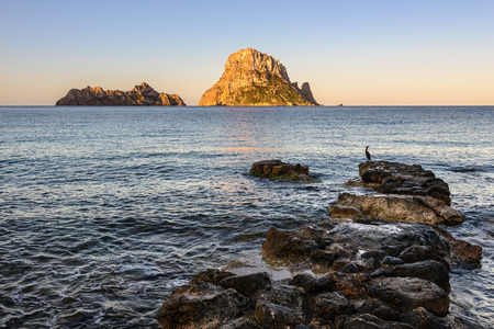 vedra: Cala dHort beach at sunrise, Es Vedra as background, Ibiza, Spain