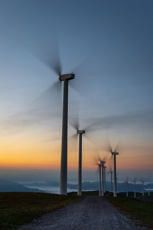 Wind turbines farm at dawn, Oiz mountain, Basque Country, Spain
