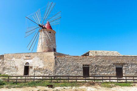 Windmill at the salt flats of Trapani, Sicily, Italy