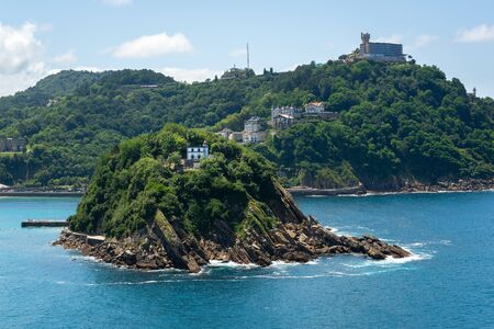 Santa Clara island and Igueldo mountain in the bay of San Sebastian - Donostia, Basque Country, Spain