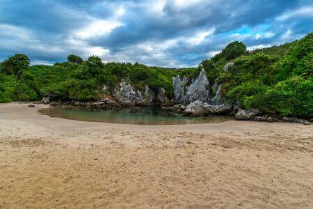 Gulpiyuri beach, inland beach located near Llanes, Asturias, Spain
