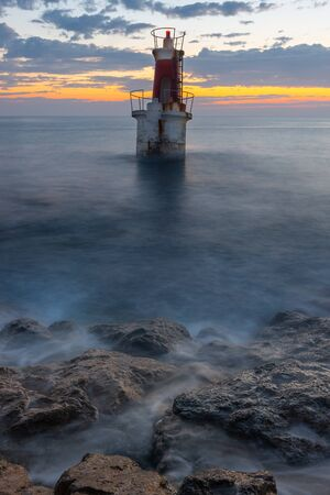 Lighthouse at the entrance of San Vicente de la Barquera harbor, Cantabria, Spain