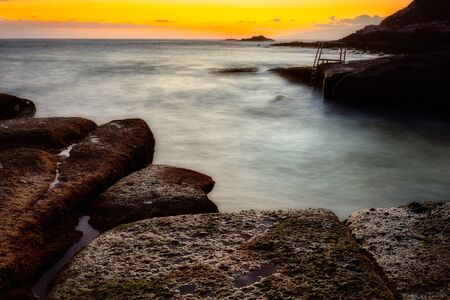 Stairs in La Caleta beach at sunset, Tenerife Island, Spain 版權商用圖片