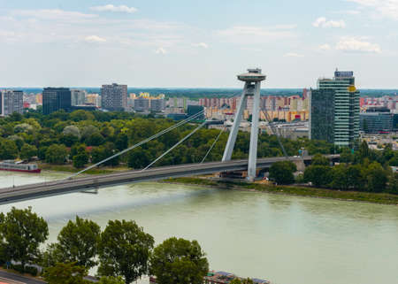 Skyline of Bratislava and Most SNP (Slovak National Uprising) or UFO Bridge, road bridge over the Danube