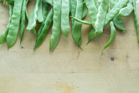 Green beans on a wood table. Ecological vegetables