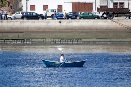 conde: Vila do Conde - Portugal - June 2011. Oars boat O Canote in IX Meeting of Traditional Boats.  Every year, traditional boats from Iberian Peninsula sails by Ave river to show their features during Saint John Editorial