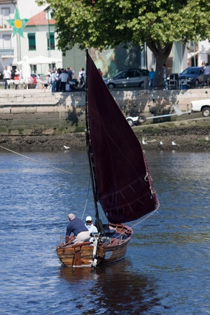 conde: Vila do Conde - Portugal - June 2011. Sailboat A Barola in IX Meeting of Traditional Boats.  Every year, traditional boats from Iberian Peninsula sails by Ave river to show their features during Saint John Editorial