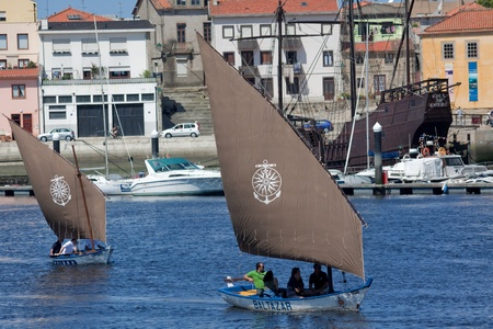 conde: Vila do Conde - Portugal - June 2011. Sailboats Baltazar and Briosa in IX Meeting of Traditional Boats.  Every year, traditional boats from Iberian Peninsula sails by Ave river to show their features during Saint John