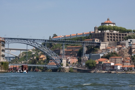 The Luis I bridge is a metal arch bridge that spans the Douro river between Porto and Vila Nova de Gaia. It was designed by a student of Eifel and has the same iron appearance as does the Parisian tower. Stock Photo - 13232432