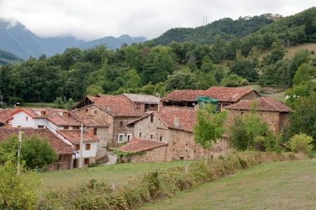Mogrovejo is a village into the mountain scenary of Picos de Europa in Spain. Its houses of stone and brick were built in the 16-18th centuries. The village has been listed as a site of historic and cultural significance. Stock Photo - 14097280