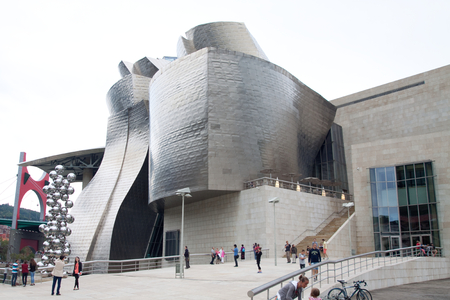 groundbreaking: Bilbao, Spain - August 7, 2013: the Guggenheim Museum Bilbao building was designed by the american architect Frank Gehry. It is an exemple of groundbreaking 20th-century architecture and a real icon of Bilbao throughout the world.