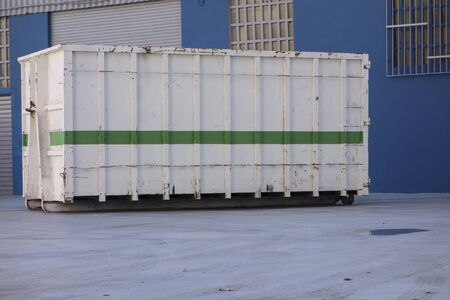ship container at the gate of a factory