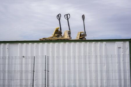 Pallet truck on top of a ship container