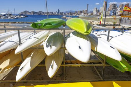 shelf full of kayaks on the beach