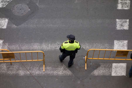 police between two yellow billboards seen from above Stock Photo