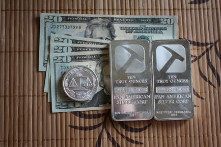 Silver bullion and cash Stock Photo - 14507782