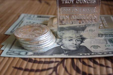 silver bullion: Silver bullion and cash Stock Photo