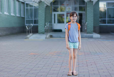 Happy girl with backpack going to school. Reklamní fotografie