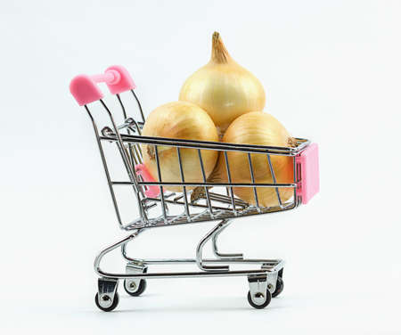 View of supermarket trolley cart with fresh onions isolated on white background. Food concept Reklamní fotografie