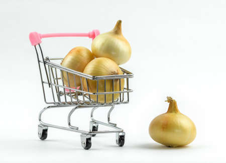 Grocery shopping cart with organic onions. Isolated on white. Reklamní fotografie