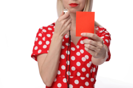 unfaithful: Divorce, Misunderstanding, Relationship problems. Woman showing red card to her husband.