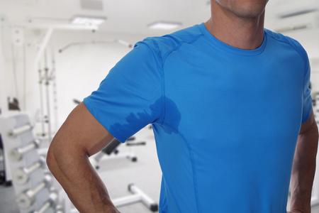 Sport man armpit sweating . Transpiration stain. Hyperthyroidism concept Stock Photo