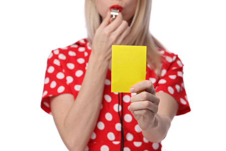 Misunderstanding, relationship problems. Woman showing yellow card to her husband.