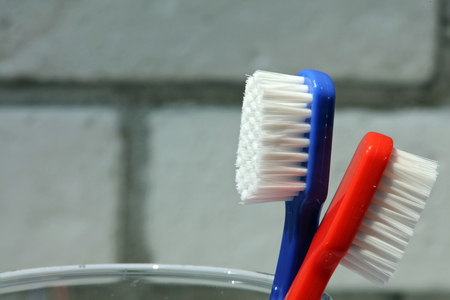 Misunderstanding, problems in relationships, different opinions concept. Male and female toothbrush standing back to back